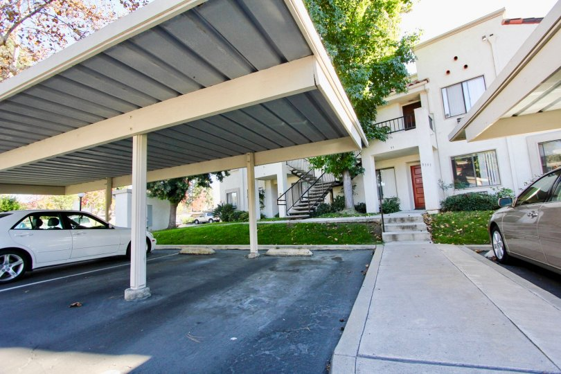 A sunny day in the area of Villas at Capricorn, outside, cars, sidewalk, car port, stairs, condos