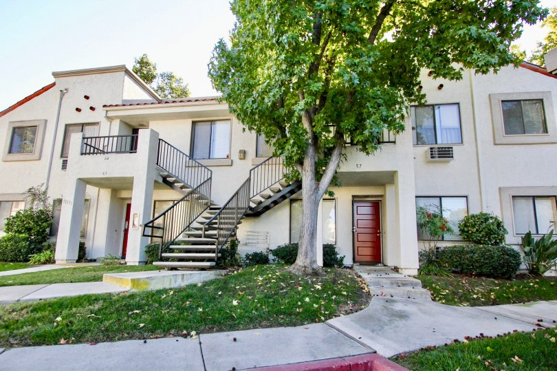 Two story housing units near walkway at Villas at Capricorn in Mira Mesa California