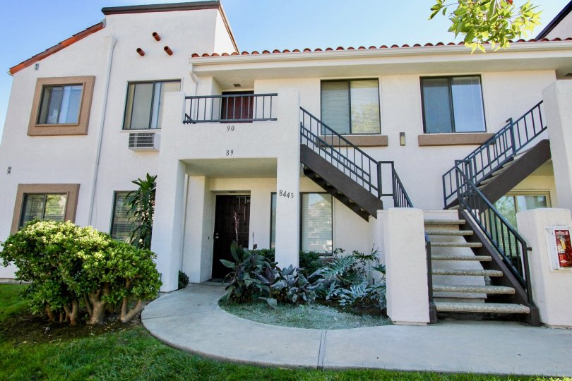 Two story residential units with attached stairways at Villas At New Salem in Mira Mesa California
