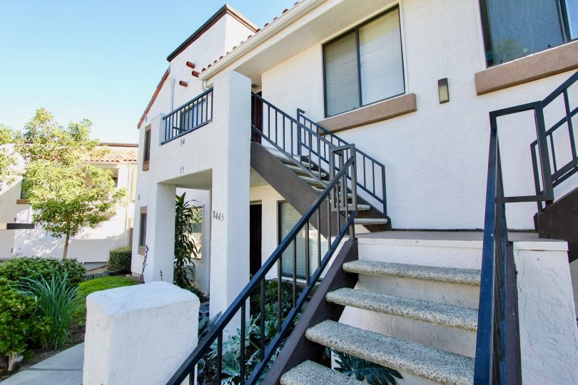Two story residential units with attached stairway at Villas at New Salem in Mira Mesa California