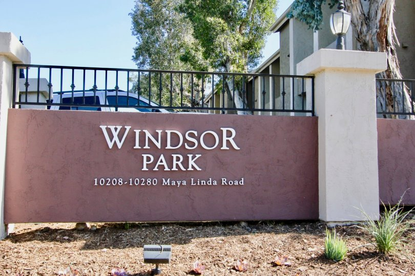 A car parked behind the entrance of Windsor Park in Mira Mesa, California