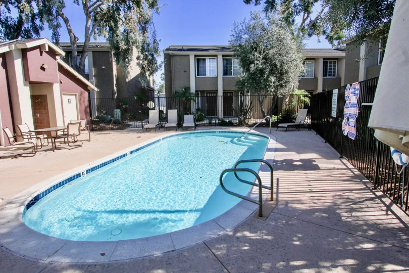 Swimming pool surrounded by residential units at Windsor Park in Mira Mesa California