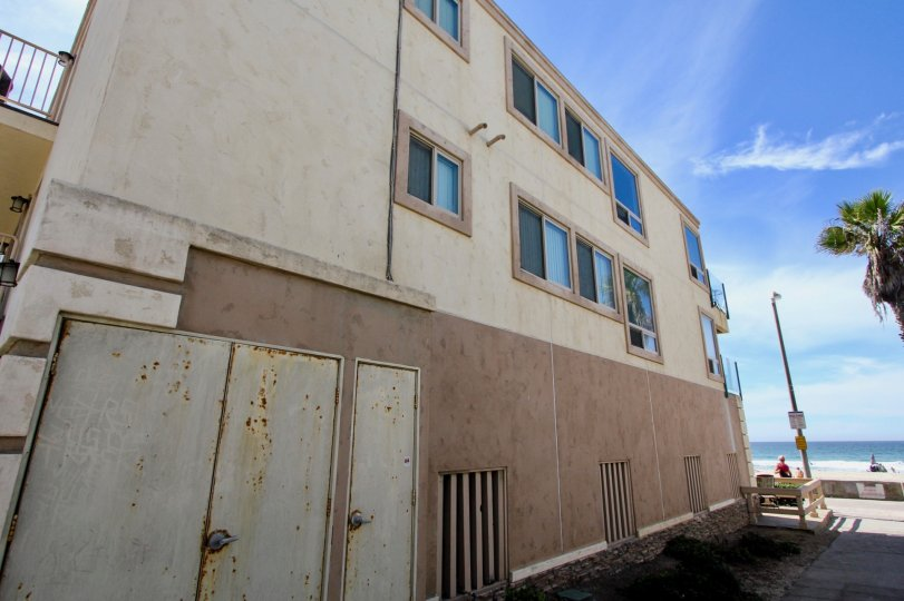 The side of the building at 3243 Ocean Front Walk in Mission Beach, California on a sunny day