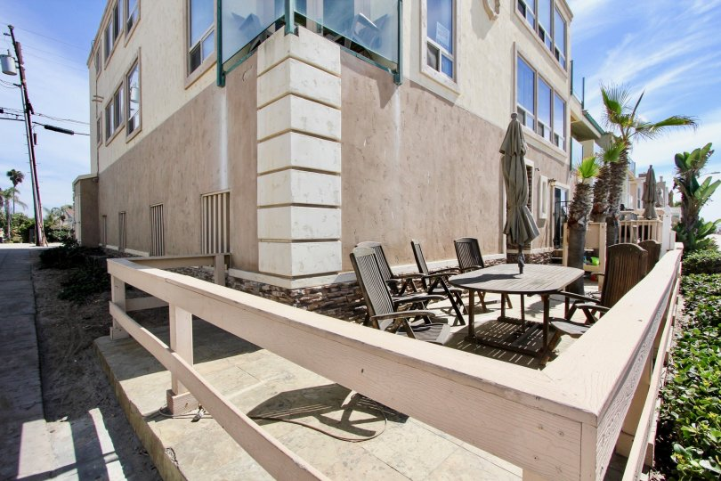 A beautiful patio set-up with table, chairs, and umbrella at 3243 Ocean Front Walk in Mission Beach, CA