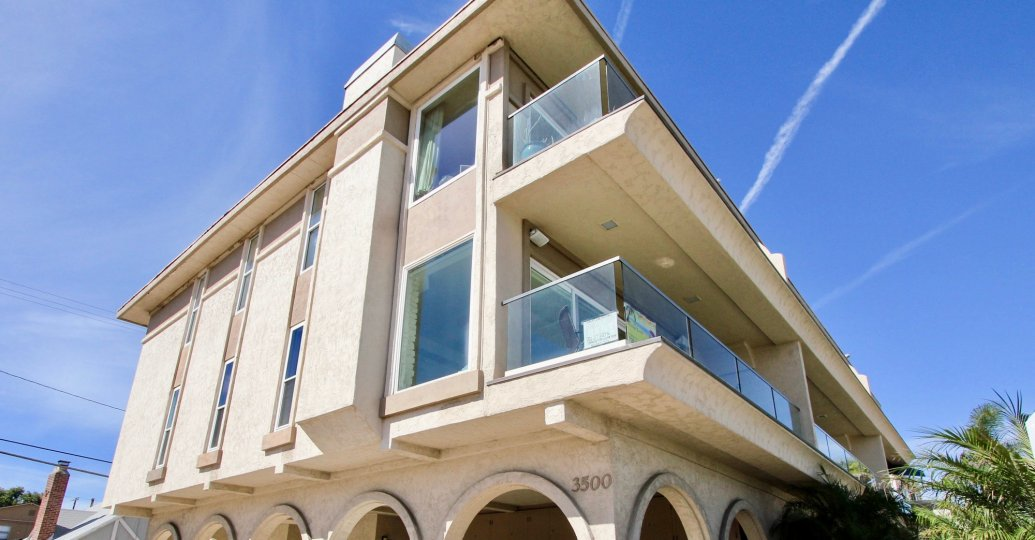 The glass balconies on 3500 Bayside Walk in Mission Beach CA.