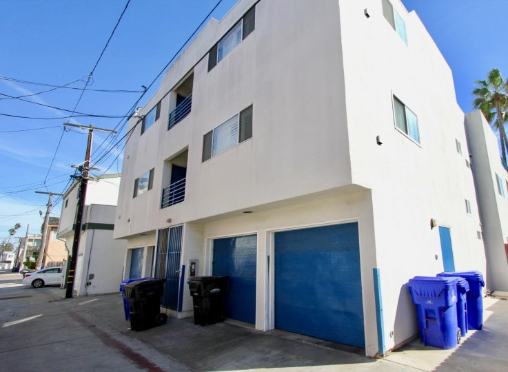 A white apartment with blue trim in Mission Beach, California