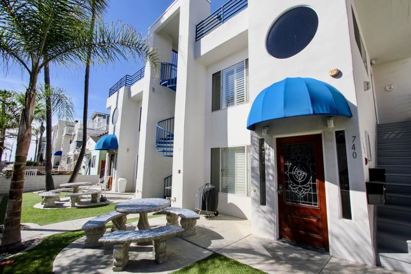 734 Ensenada Court an open condo like community with bright colors and white stone buildings