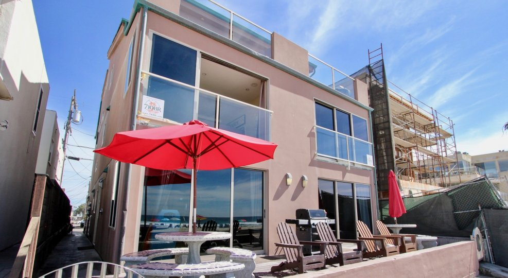 Gorgeous patio with umbrella picnic tables and deck chairs at Jersey in Mission Beach, CA