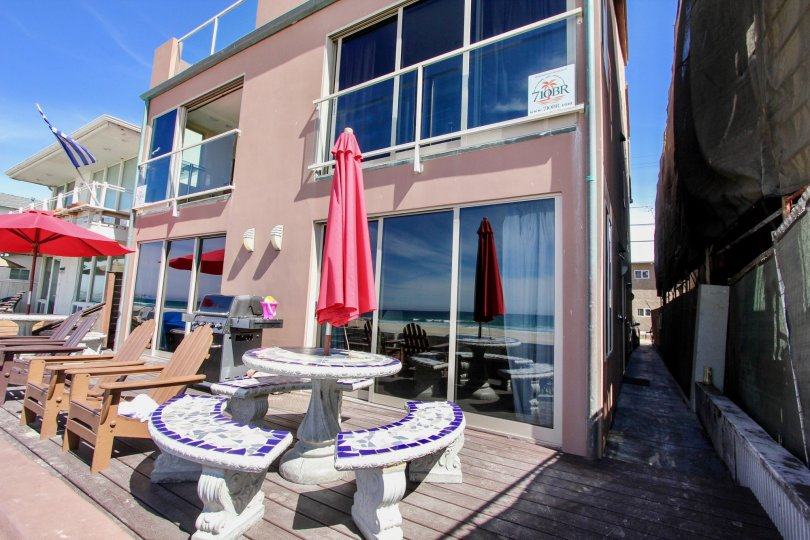 Beachfront patio tables overlooking serene view at Jersey in Mission Beach California