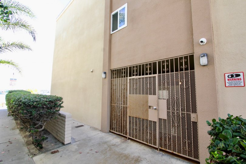 Manhattan Condominiums' gated entryway with CCTV in Mission Beach, California