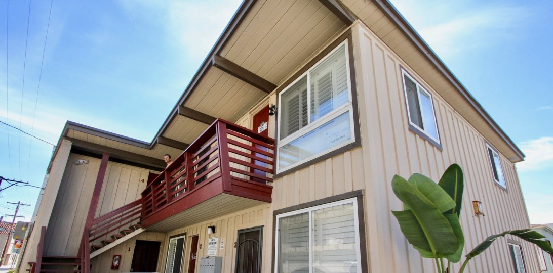 Two story brown condos with a red railing inside Mission Beach Bayside at Mission Beach ca