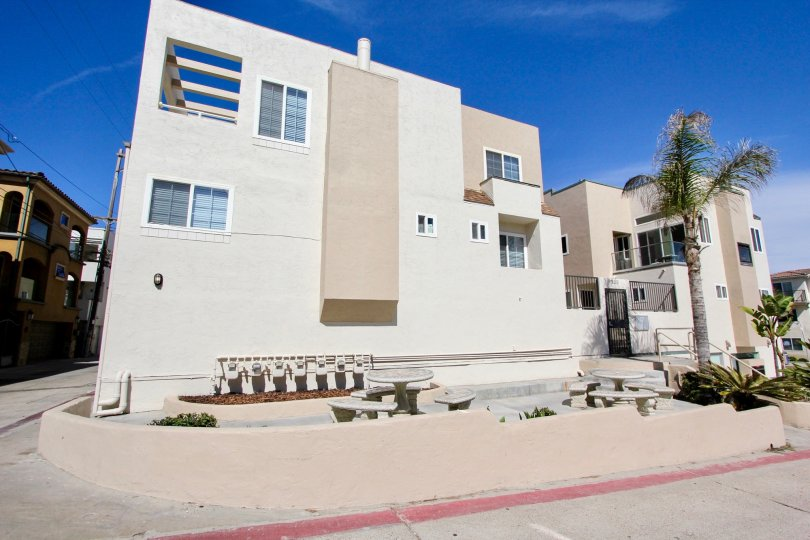 Concrete picnic benches sit in front of Mission Beach Villas