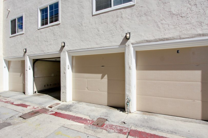 White garages with lights above them at Mission Beach Villas in Mission Beach CA
