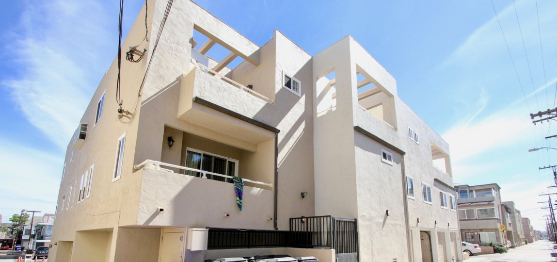 Three story white residential units at Mission Beach Villas in Mission Beach CA