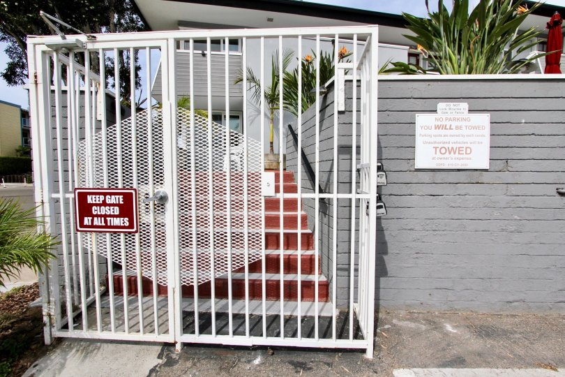 Red sign on the front of a white gate in Mission Beach CA at Mission View Point