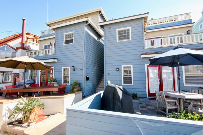 Blue beach house front with red door frames in Mission Beach.