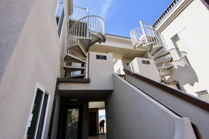The front and spiral staircases of a property in Mission Beach.