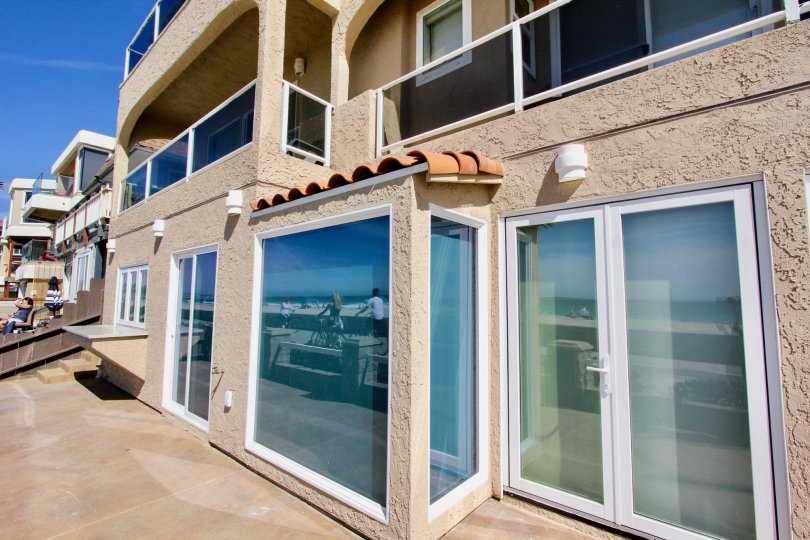 Ocean Front Villas is a beautiful 4 bedroom, 3. 5 bathroom vacation rental at the end of the Boardwalk in South Mission Beach, San Diego. This home not only has ocean and beach views, but also overlooks the channel leading from Mission Bay to the ocean, a