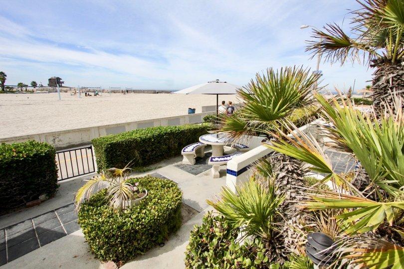 A patio table overlooks a beach at Ocean Vail condos.