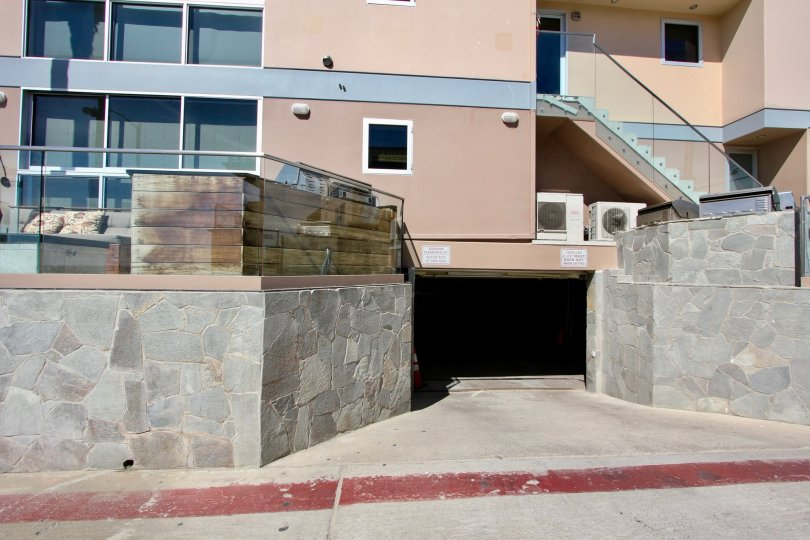 Looking DOwn the Driveway into the parking garage at the San Juan Condominiums in Mission Meach, CA