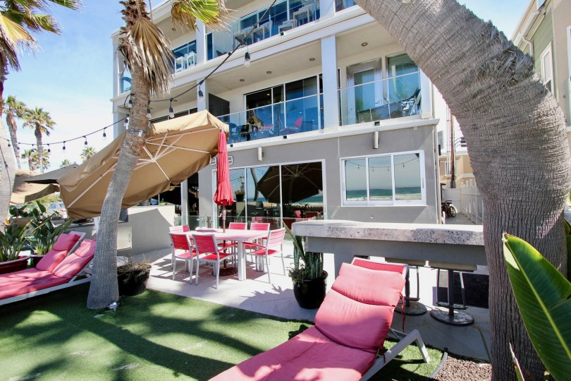 Pink lounge chairs sit on AstroTurf at South Beach condos