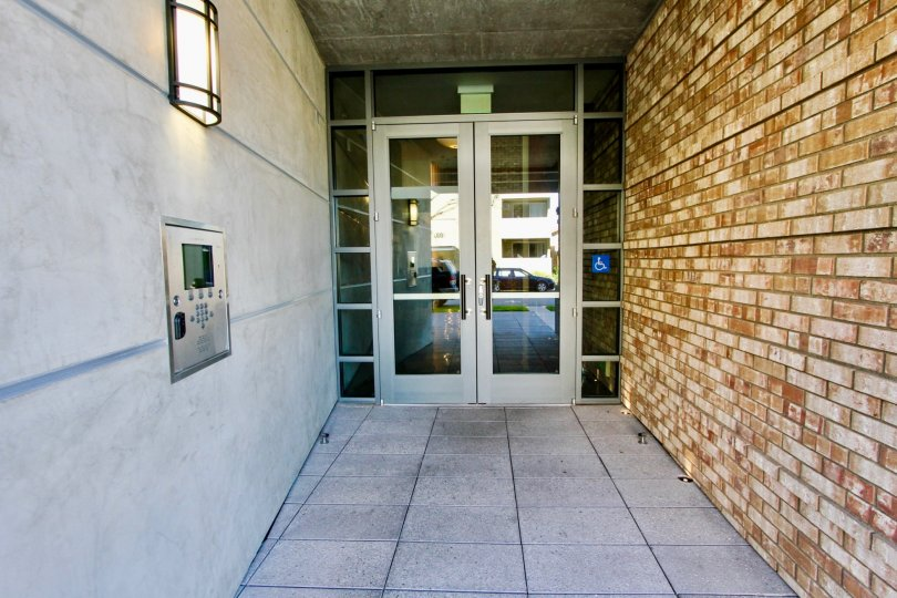 Front door to luxury apartment complex in Mission Hills