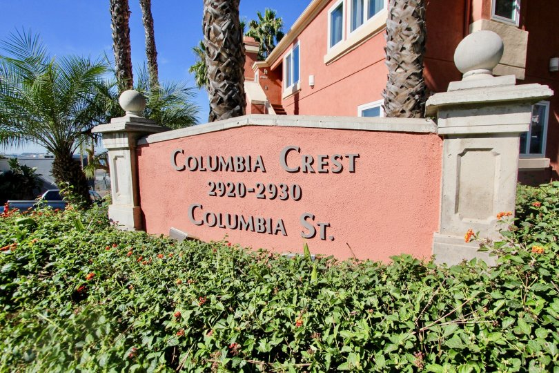 The wall surrounded with bushes and trees has Columbia Crest 2920-2930 Columbia St. at city Mission Hills