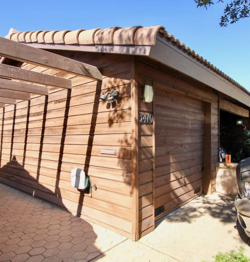 A garage with wooden exterior during a sunny day in Columbia Point, Mission Hills, CA