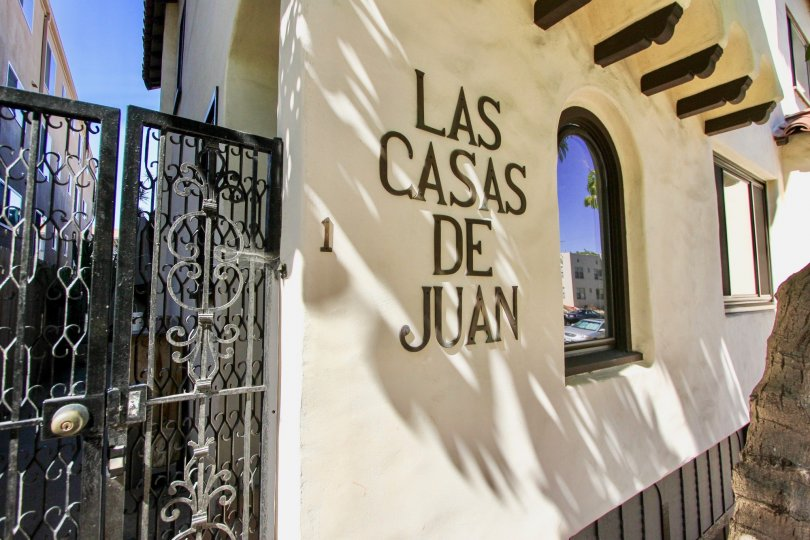 Front of a residence with label in wall in the Las Casas De Juan