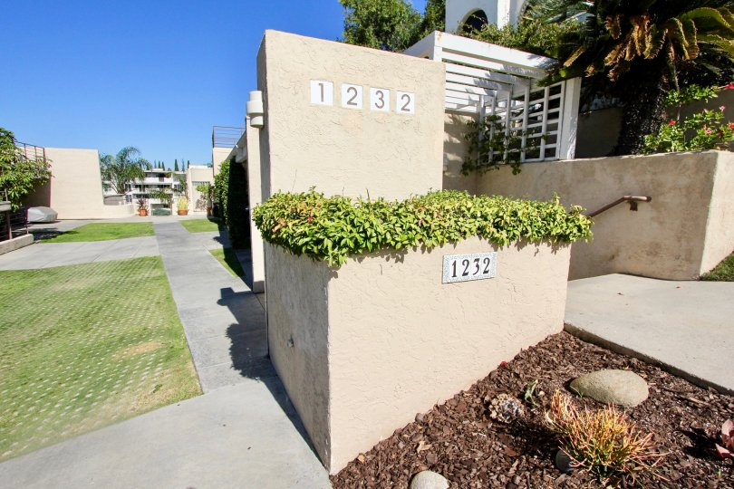 Path way of the Redwood Condominiums marked number with 1232 and has meadows
