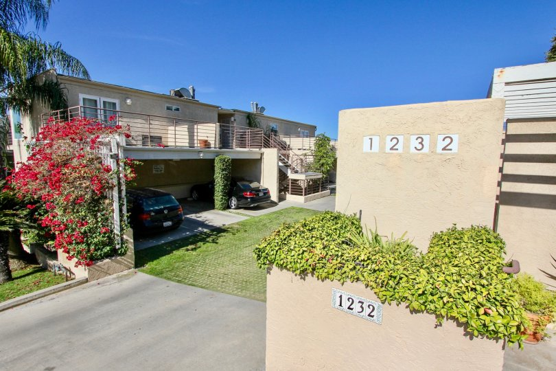 A beautiful afternoon at the Redwood Condominiums in Mission Hills, CA with green grass and sunny skies!