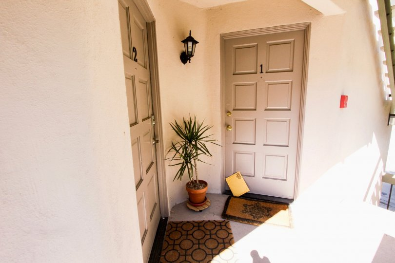 The entrance to two apartments in Torrance Townhomes Community located in Mission Hills, CA