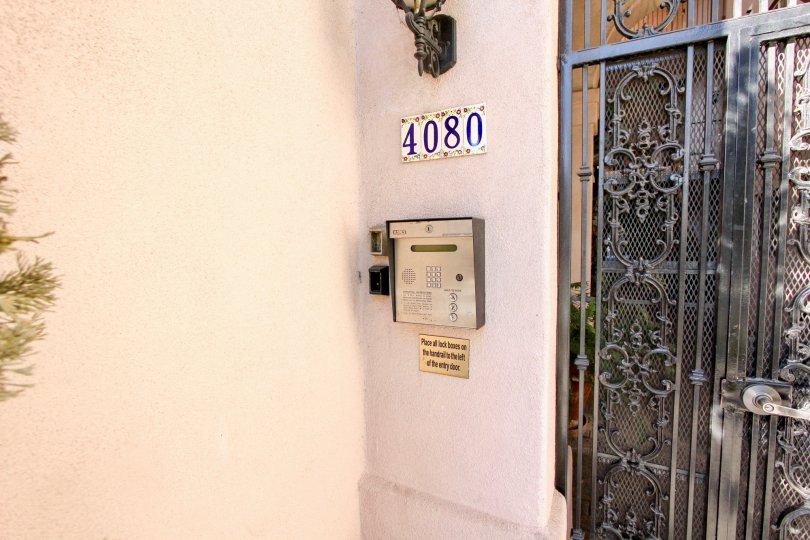 A gate with a street number and intercom at Villa Portofino on Front, Mission Hills, CA