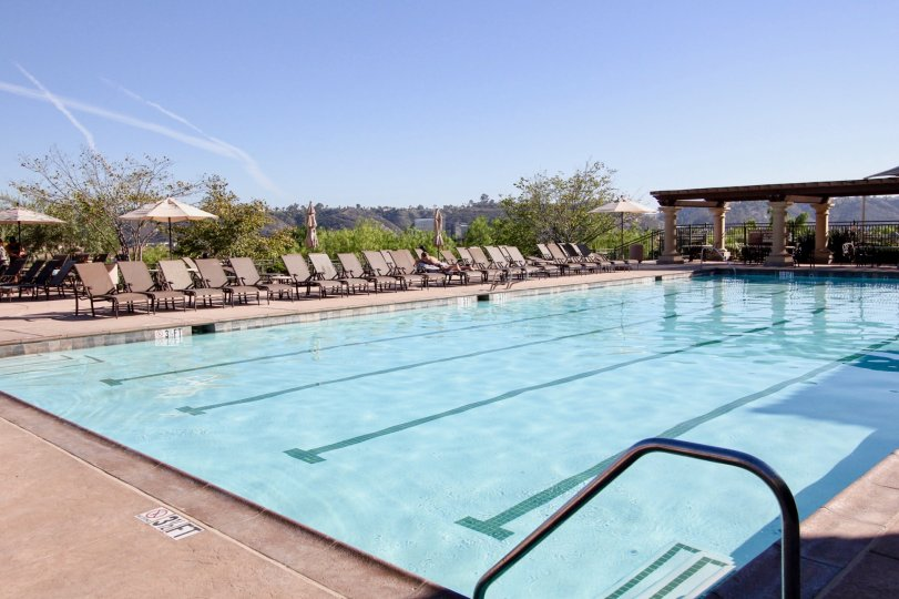 Large rectangle swimming pool with pillars at Bridges at Escala in Mission Valley CA
