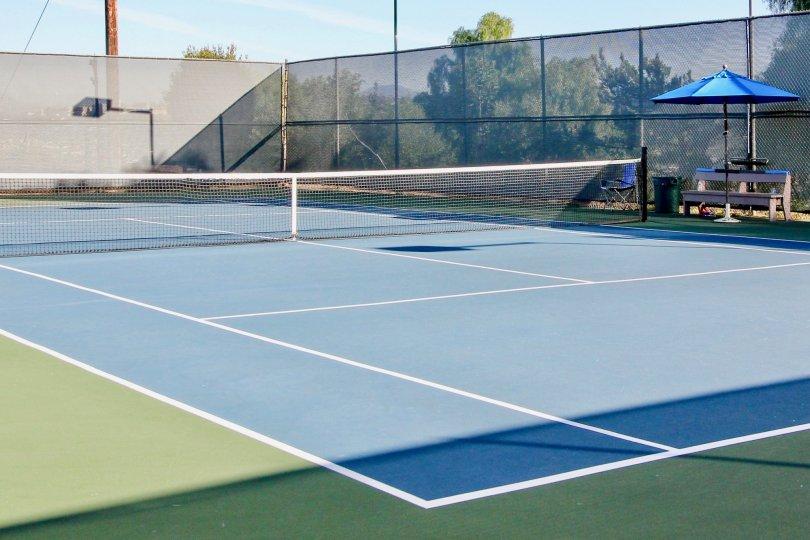 A tennis court on a sunny day in Cerro De Alcala community in Mission Valley, California.