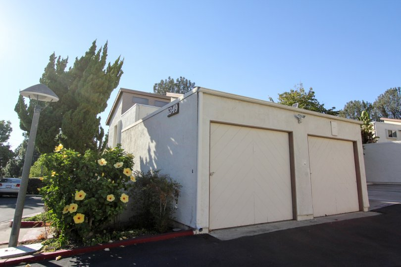 Adorable little house in the Cerro De Alcala community of Mission Valley, California, with 2 garage doors.