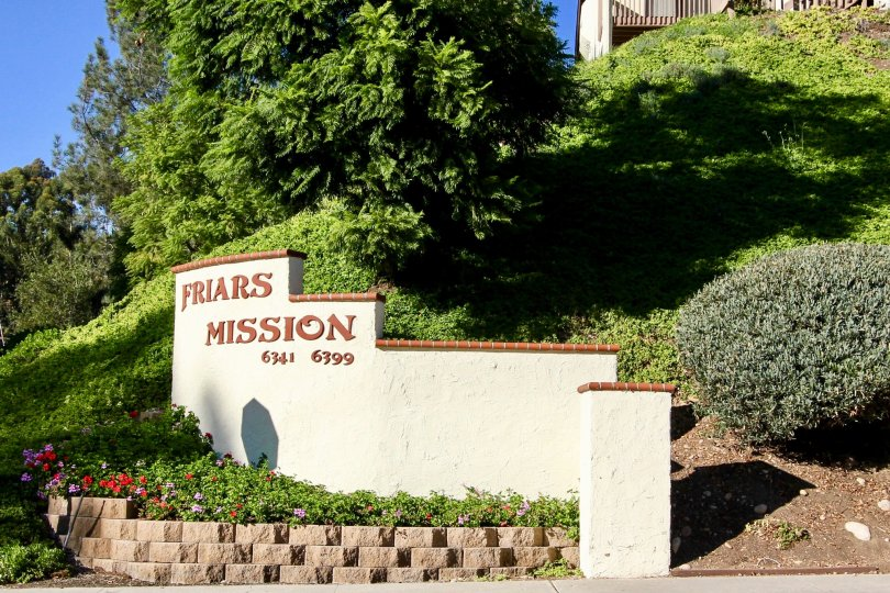 The entrance to Friars Mission is nicely landscaped with a cement sign that lists the address.