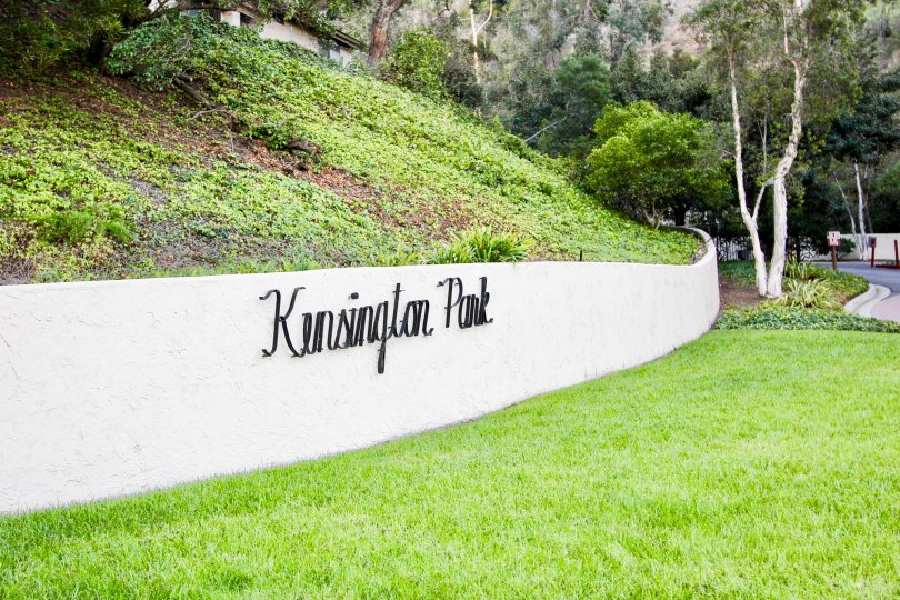 View of landscape and sign of Kensington Park Villas Mission Valley California