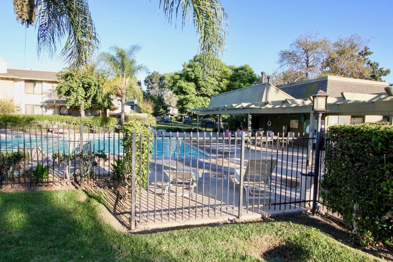 Black iron fence around a large swimming pool at Mission Playmor in MIssion Valley California