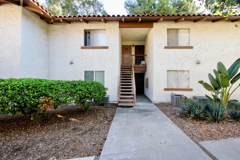 Two story home with attached stairway inside MIssion Plaza at Mission Valley CA