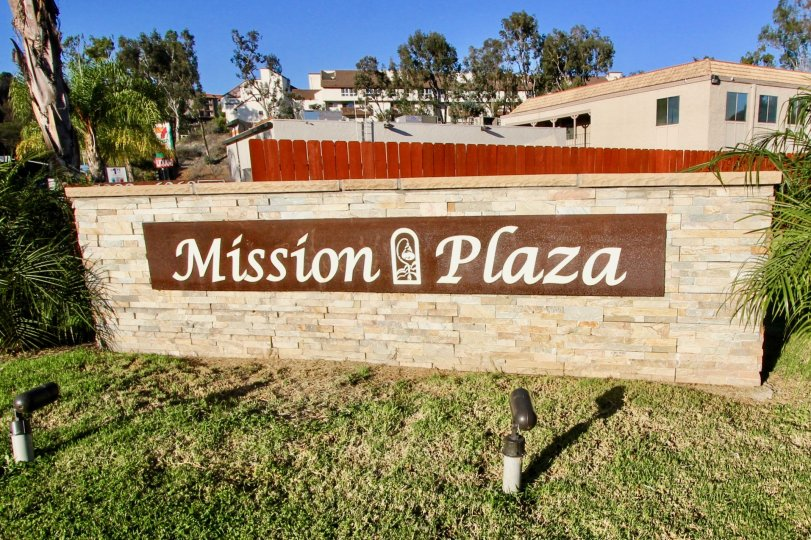 Entrance of Mission Plaza in Mission Valley California with homes and trees in the background