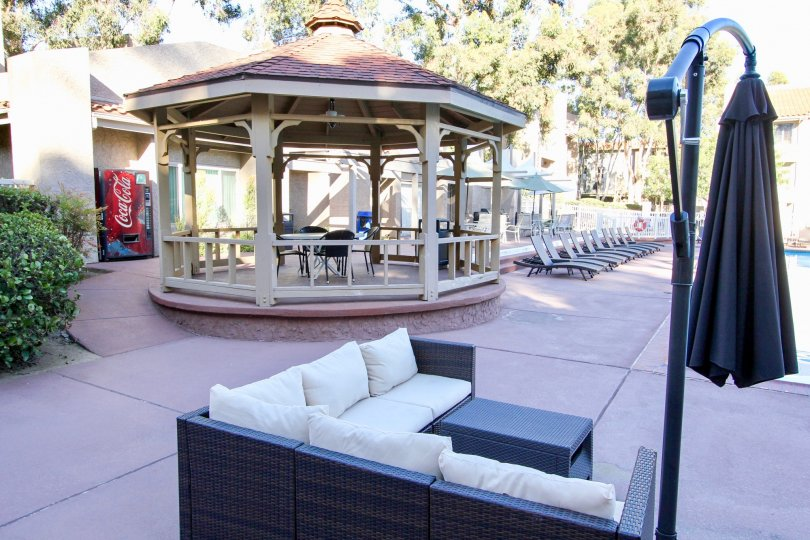 Poolside area with chairs and a white gazebo in Mission Ridge, California