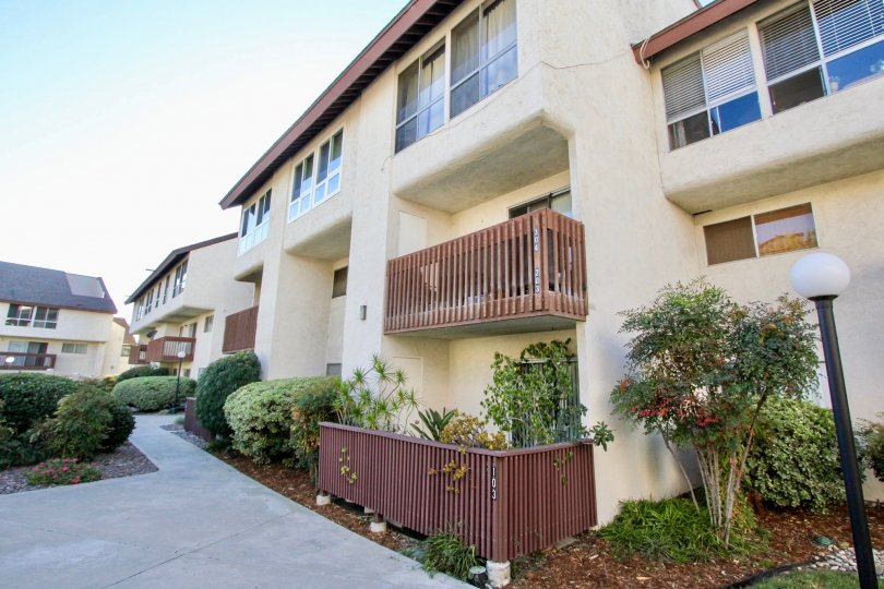 A sunny day in Mission Verde apartment complex with green landscaping