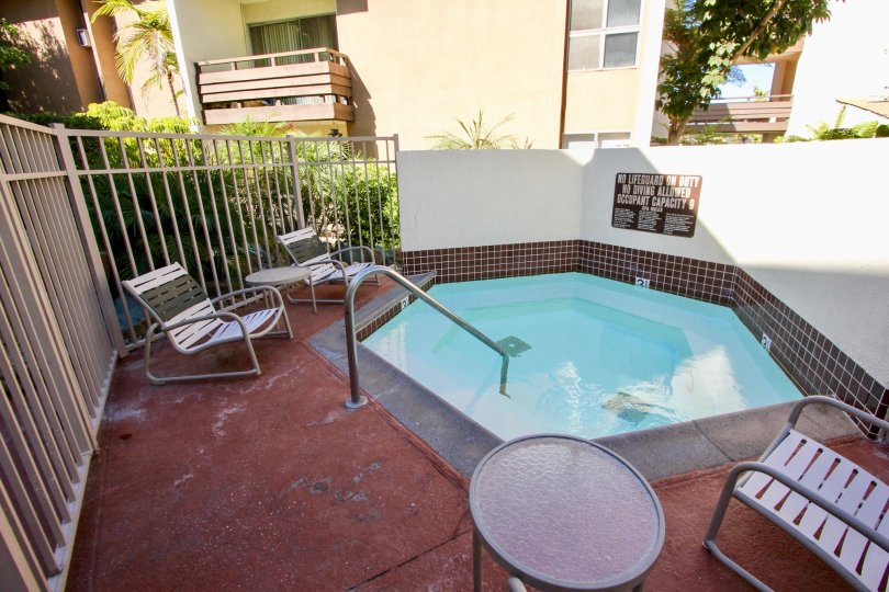 Mission Village in Mission Valley, California has a clean and functioning hot tub for you to wind down in at the end of a long day. Come home to a terrace with lounge chairs and relax.