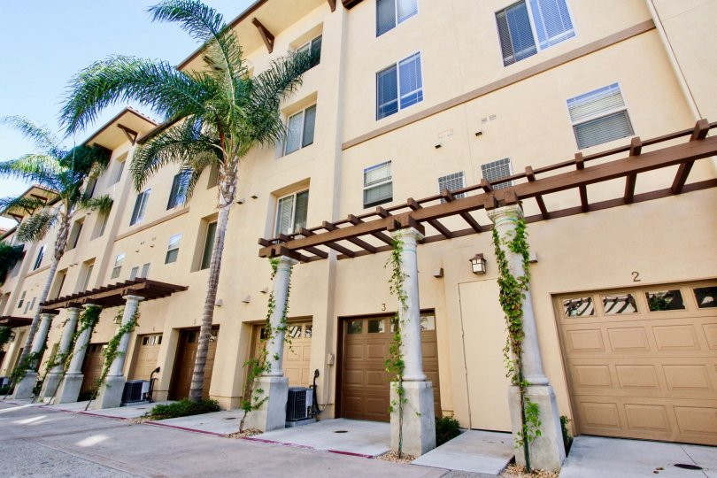 Apartment complex with nice paint job and palm trees in Mission Valley California