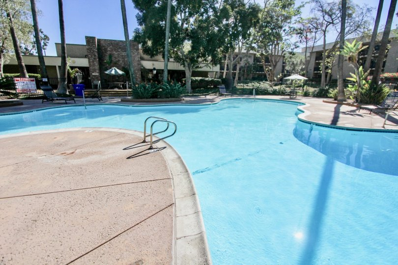 A cute swimming pool with calm blue water in the Bluffs community