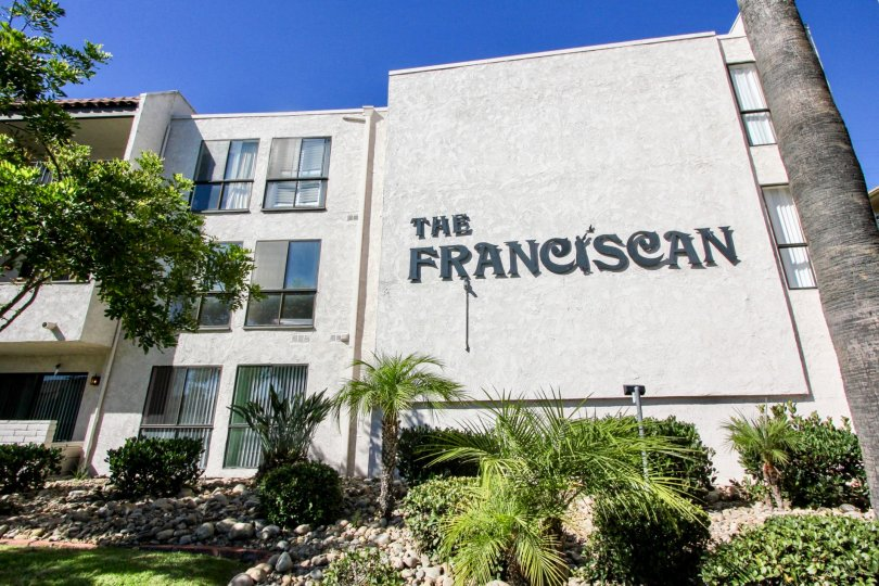 Outside of The Franciscan located in Mission Valley, CA showing logo on the front of building