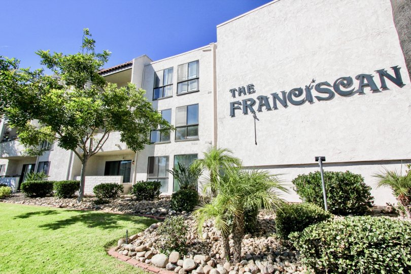 A view of The Franciscan sign and apartment buildings in Mission Valley, California