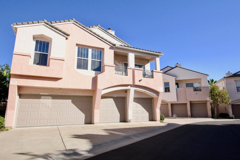 Two story pink town homes with three garages inside Union Square at Mission valley CA