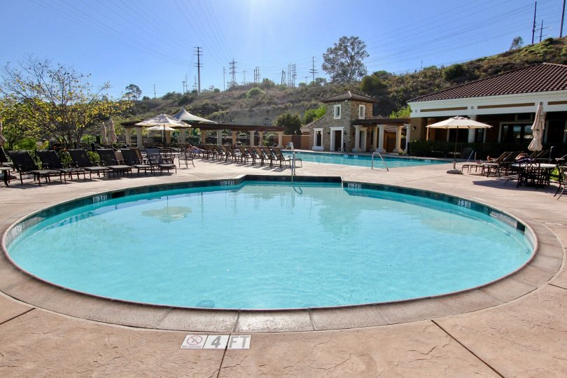Huge round pool next to a second pool at Verandas at Escala in Mission Valley CA